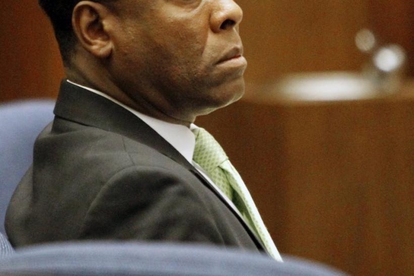 Dr. Conrad Murray watches his former patient, Robert Russell, testify during Murray's involuntary manslaughter trial in the death of pop star Michael Jackson in Los Angeles