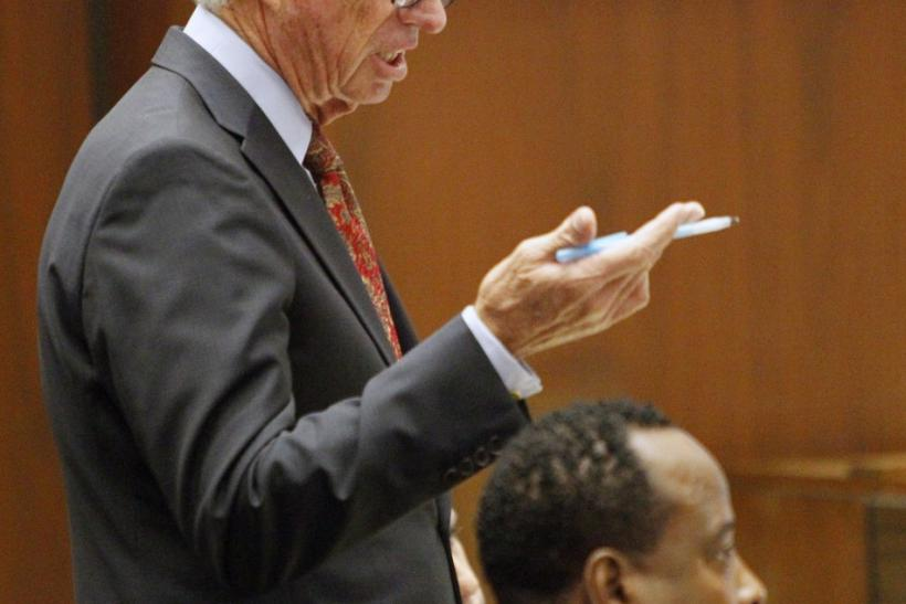 Defense attorney J. Michael Flanagan questions prosecution witness Robert William Johnson in Dr. Conrad Murray's involuntary manslaughter trial in the death of pop star Michael Jackson in Los Angeles
