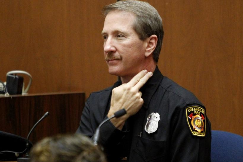 Prosecution witness and paramedic Richard Senneff (R) testifies in Dr. Conrad Murray's involuntary manslaughter trial in the death of pop star Michael Jackson in Los Angeles