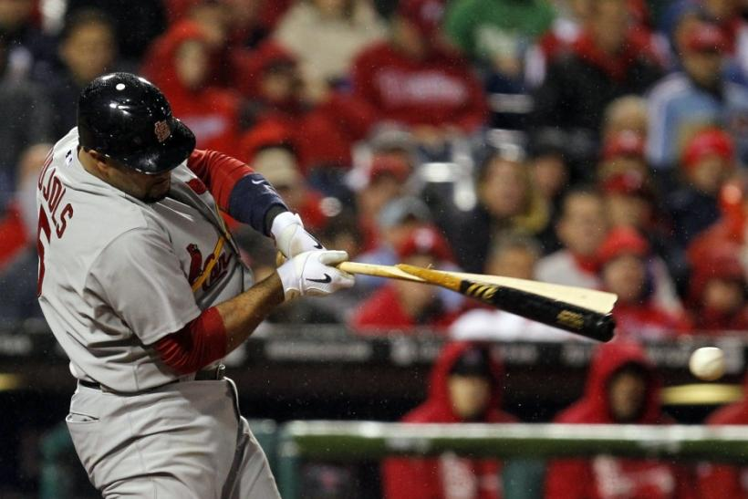 St. Louis Cardinals' Albert Pujols hits a broken bat single against the Philadelphia Phillies in the ninth inning of Game 2 of their MLB National League Divisional Series baseball playoffs in Philadelphia