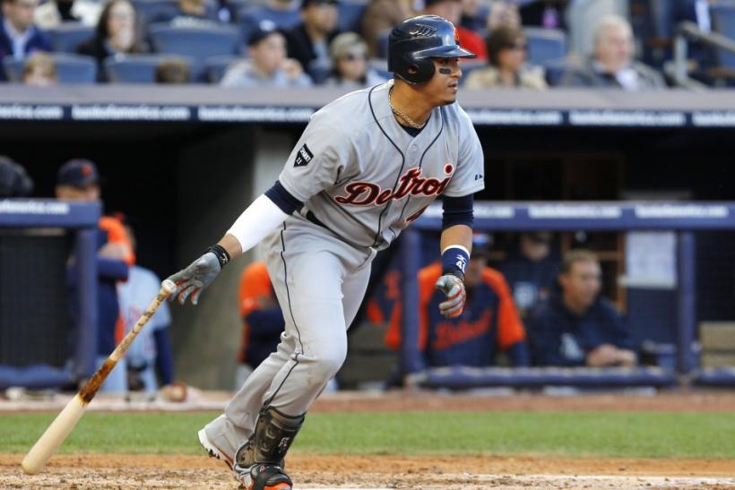 Detroit Tigers' Victor Martinez hits an RBI single against the New York Yankees in Game 2 of their MLB American League Division Series baseball playoffs in New York
