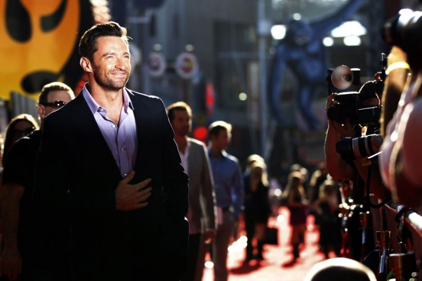 "Cast member Hugh Jackman poses for photographers at the movie premiere of ""Real Steel"" in Los Angeles"