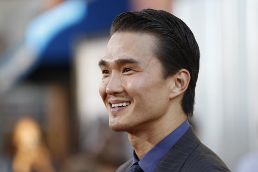 "Cast member Karl Yune poses for photographers at the premiere of ""Real Steel"" in Los Angeles"
