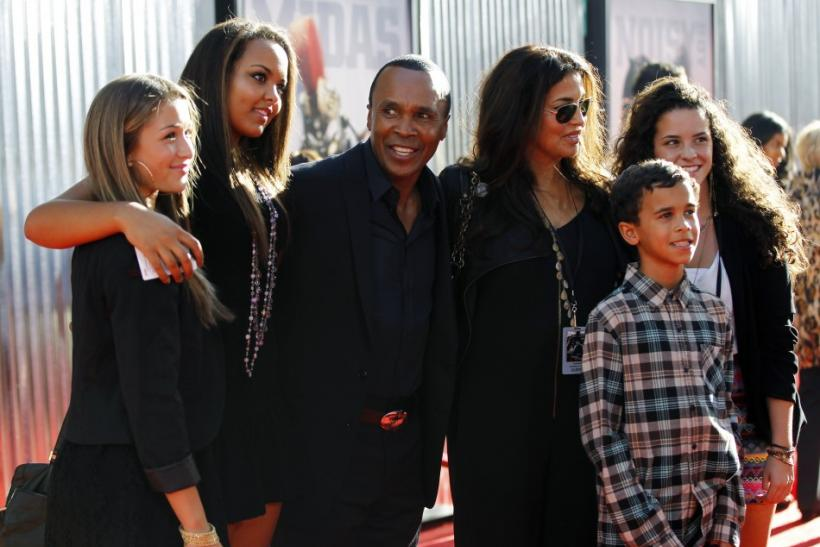 "Former boxer Sugar Ray Leonard poses with his wife Bernadette Robi (3rd R) and family at the premiere of ""Real Steel"" in Los Angeles"