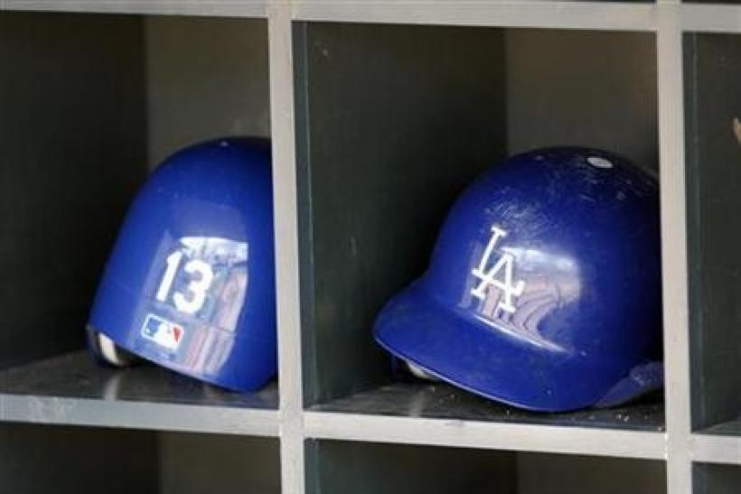 Los Angeles Dodgers batting helmets are seen in the dugout before the start of their American League MLB baseball game against the Minnesota Twins at Target Field in Minneapolis