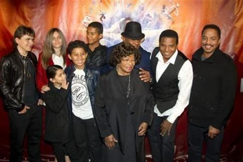 The family of late singer Michael Jackson, including his children Prince Michael Joseph Jackson Jr. (far L) , Paris-Michael Katherine Jackson (2nd L) and Prince Michael Jackson II (L front), his brother's children Jaffar Jackson (3rd L back), Jermaje