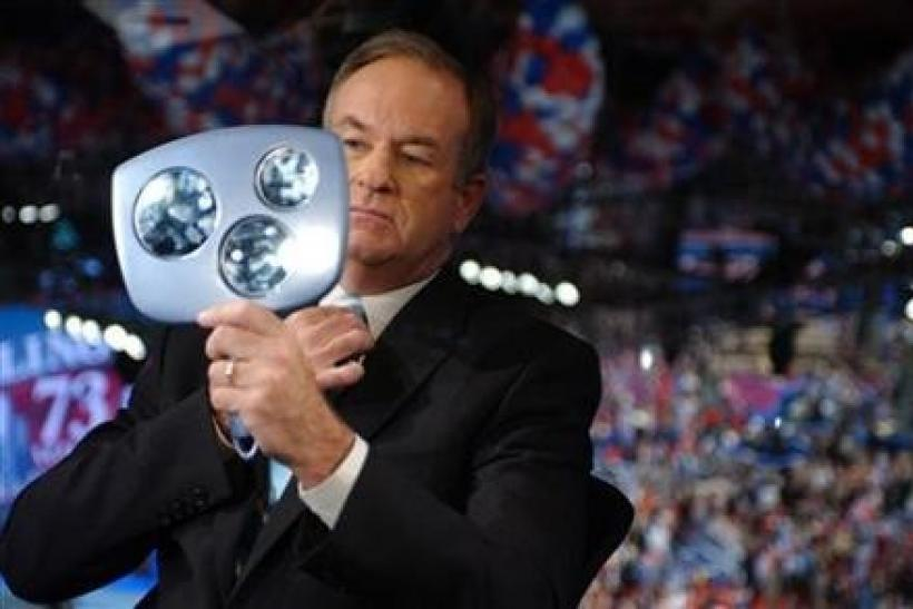 Television commentator Bill O'Reilly checks himself in a mirror prior to interviewing Bono, lead singer of the Irish rock group U2, during the third night of the 2004 Republican National Convention, at Madison Square Garden in New York