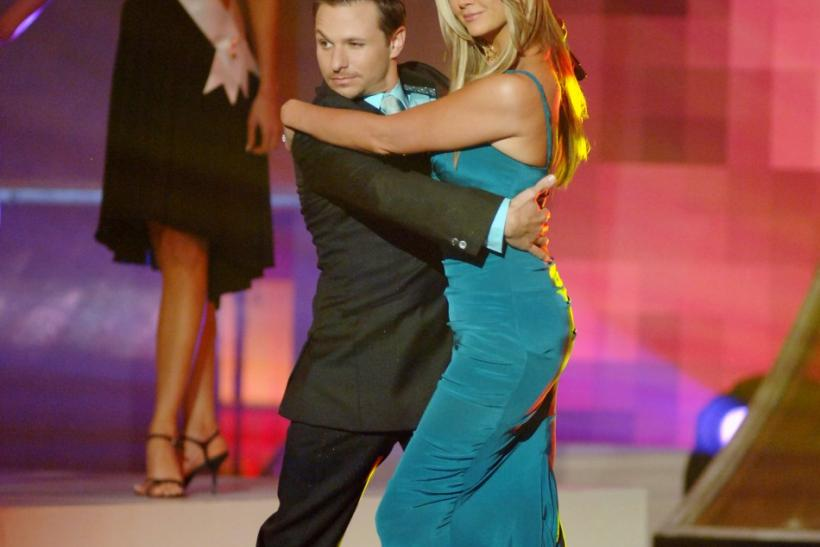Miss USA 2006 co-hosts Lachey and O'Dell make their entrance during the broadcast of the Miss USA competition in Baltimore
