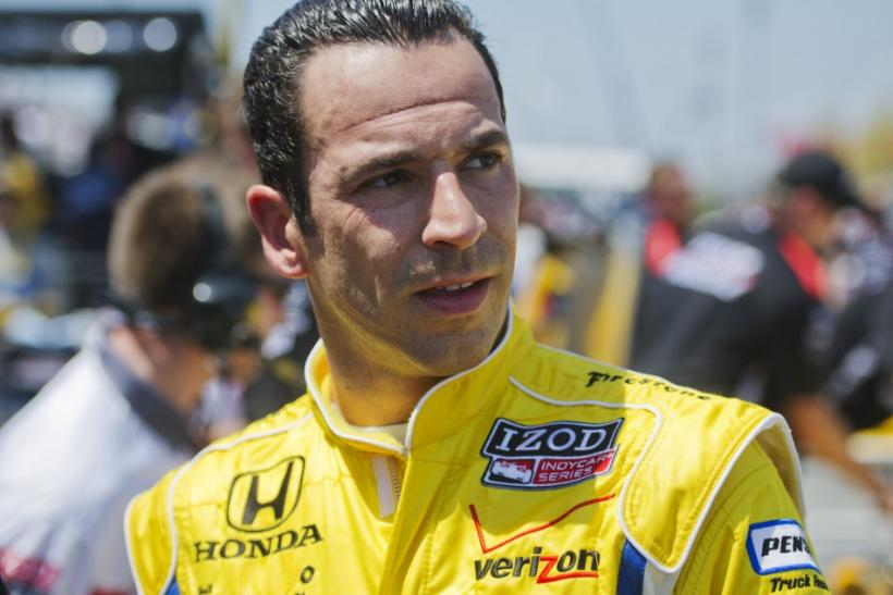 Team Penske's Helio Castroneves of Brazil looks on after practice sessions at the Honda Indy Toronto in Toronto
