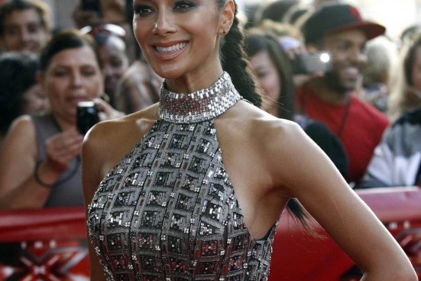 "Nicole Scherzinger poses at the world premiere of ""The X Factor"" in Hollywood"