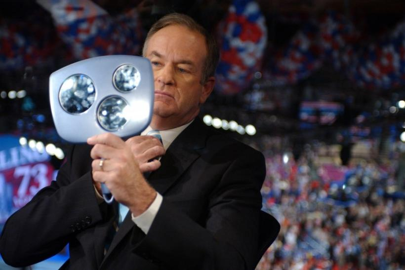 Commentator Bill O Reilly checks himself in mirror before interview at Republican National Convention.