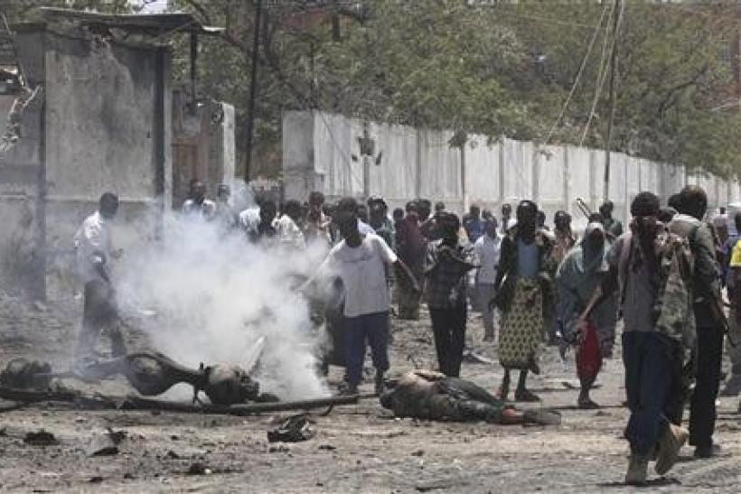 "Residents gather at the scene of a suicide attack in Somalia""s"