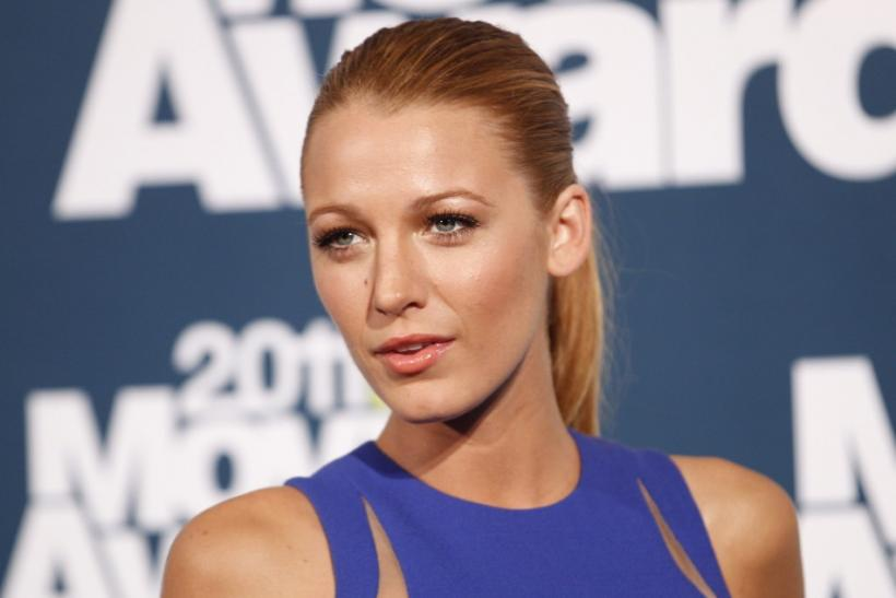 Actress Blake Lively poses for photographers in the photo room at the 2011 MTV Movie Awards in Los Angele