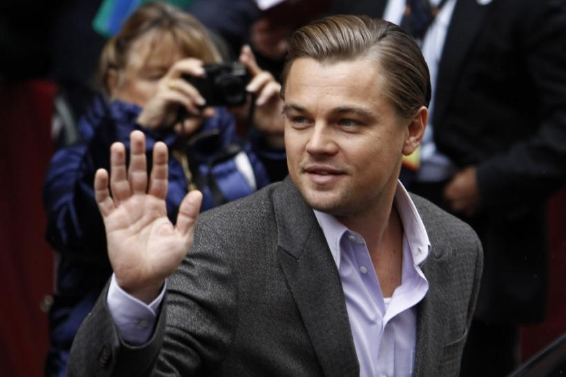 "Actor DiCaprio waves to supporters as he arrives for a photocall to promote the movie ""Shutter Island"" at Berlinale in Berlin"