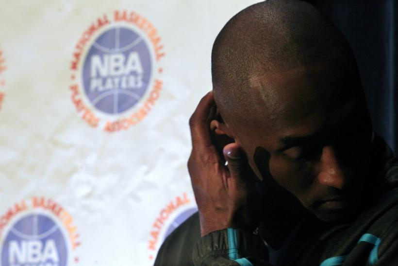 Los Angeles Lakers Kobe Bryant listens during a news conference following NBA labor meetings in New York
