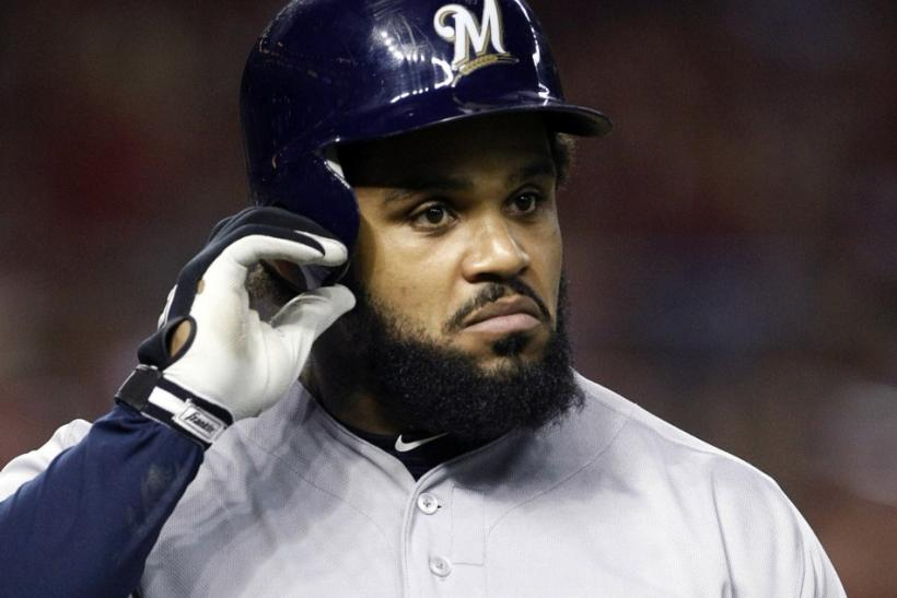 Brewers Prince Fielder walks back to the dugout after striking out against the Arizona in Phoenix