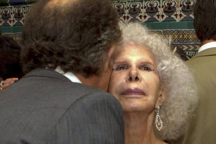 Spain's Duchess of Alba Cayetana Fitz-James Stuart y Silva is kissed by her husband Alfonso Diez after their wedding ceremony in Seville
