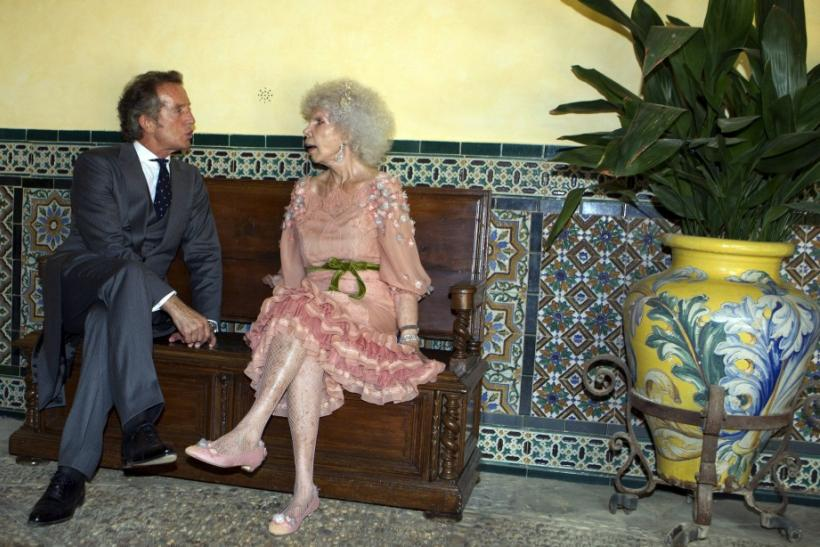 Spain's Duchess of Alba Cayetana Fitz-James Stuart y Silva and her husband Alfonso Diez talk after their wedding ceremony in Seville