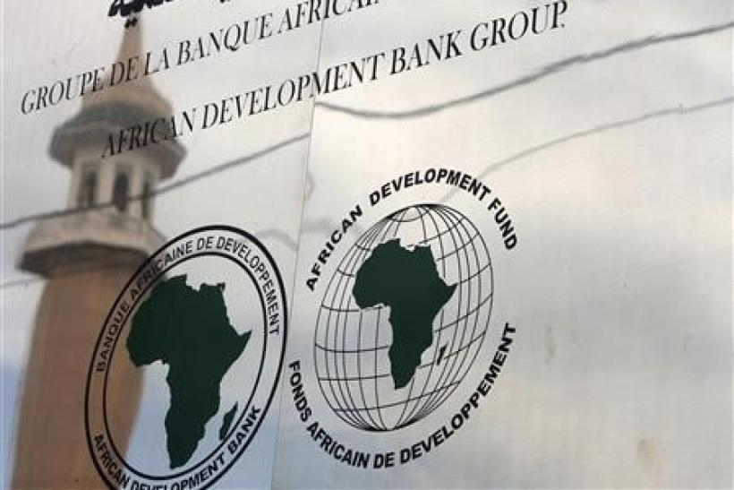A minaret is reflected in the signage for the newly inaugurated African Development Bank