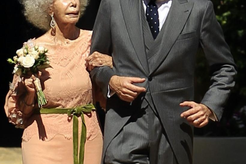 Spain's Duchess of Alba Cayetana Fitz-James Stuart y Silva (L) and her husband Alfonso Diez walk inside Las Duenas Palace after their wedding in Seville