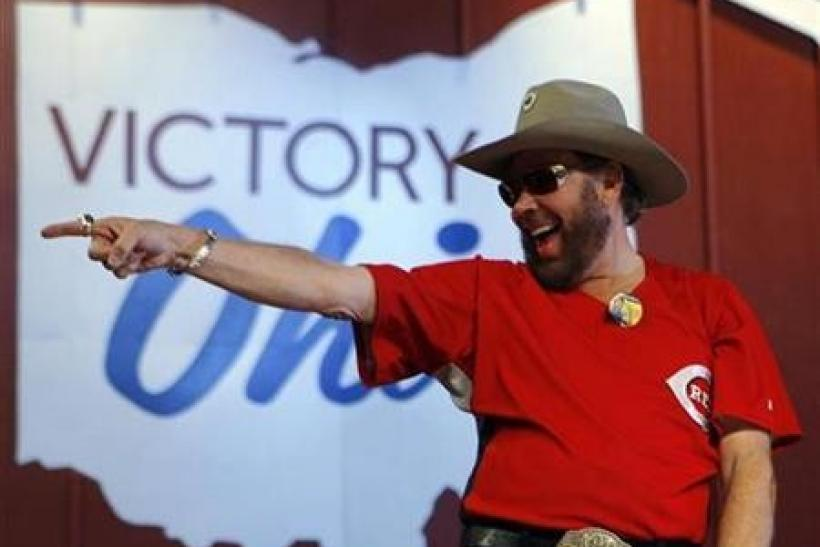 Singer Hank Williams Jr. points into the crowd at a campaign rally with Senator John McCain in Columbus, Ohio