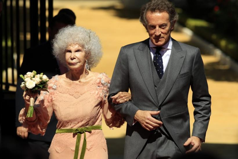 Spain's Duchess of Alba Cayetana Fitz-James Stuart y Silva (L) and her husband Alfonso Diez pose at the entrance of Las Duenas Palace after their wedding in Seville