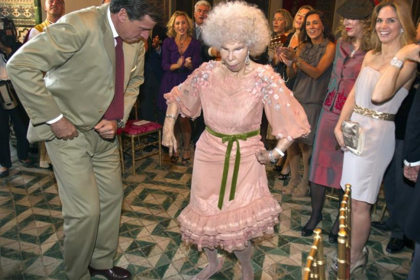 Spain's Duchess of Alba Cayetana Fitz-James Stuart y Silva (R) dances flamenco with her son Cayetano Martinez de Irujo after her wedding with Alfonso Diez at Las Duenas Palace in Seville