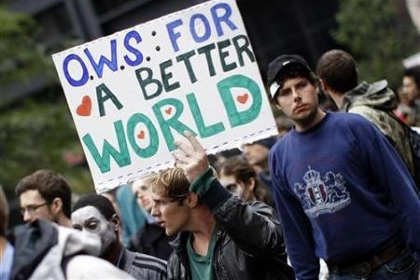A demonstrator holds a sign during an Occupy Wall Street protest in lower Manhattan in New York