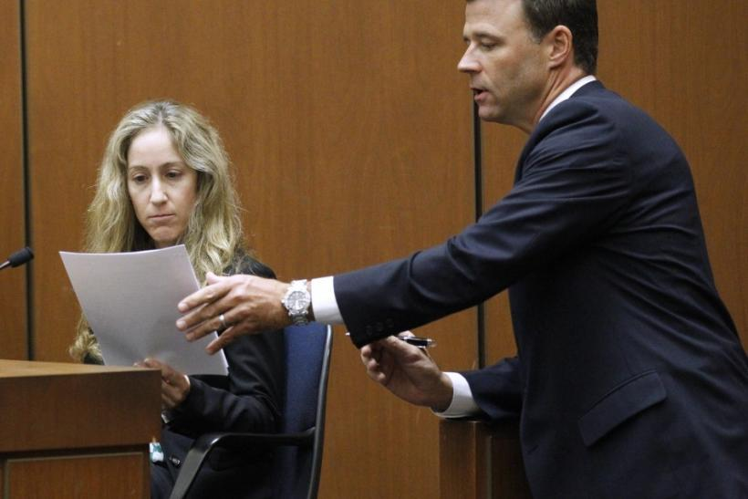 David Walgren questions Dr. Richelle Cooper during Dr. Conrad Murray's trial in the death of pop star Michael Jackson in Los Angeles