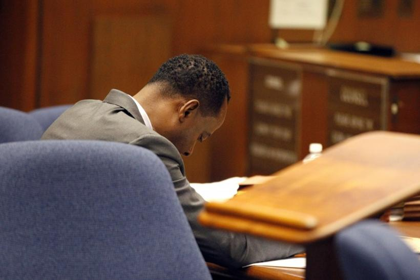 Dr. Conrad Murray looks down at the defense table during trial in the death of pop star Michael Jackson in Los Angeles