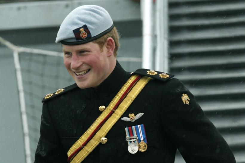 Britain's Prince Harry, disembarks from HMS Cattistock during a visit to Portsmouth Naval Base, in Portsmouth
