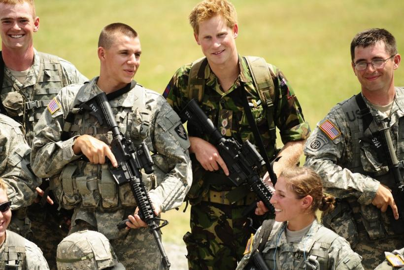 Britian's Prince Harry poses with US military cadets during a visit to the US Military Academy at West Point in New York
