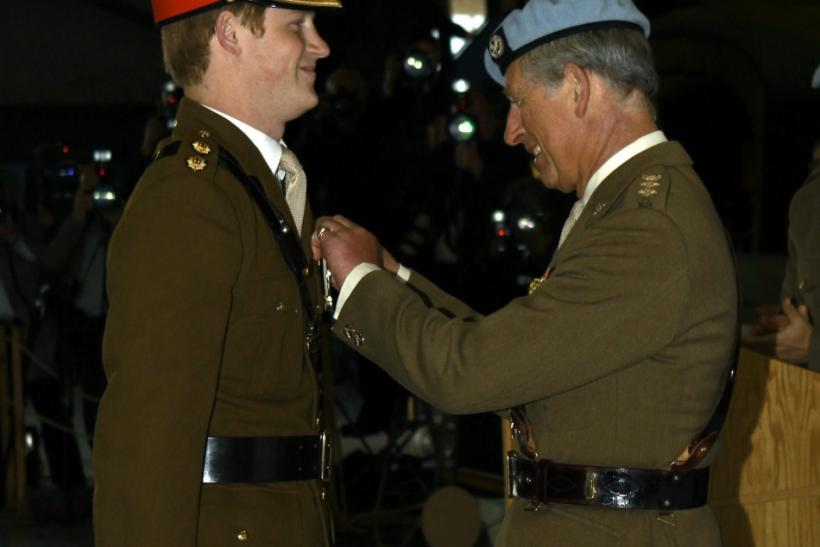 Britain's Prince Harry smiles as he receives his wings from his father Prince Charles at the Army Aviation Centre at Middle Wallop