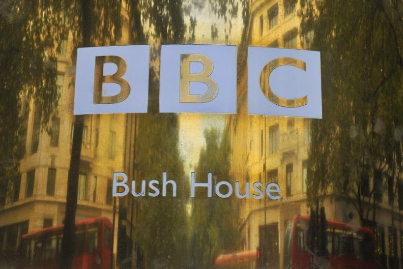 Buildings are reflected in a sign at British Broadcasting Corporation offices in central London