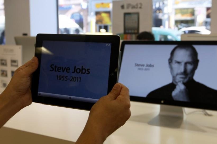A customer holds an iPad in an Apple store in central Prague