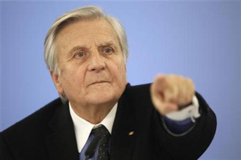 European Central Bank President Trichet gestures during news conference in Berlin