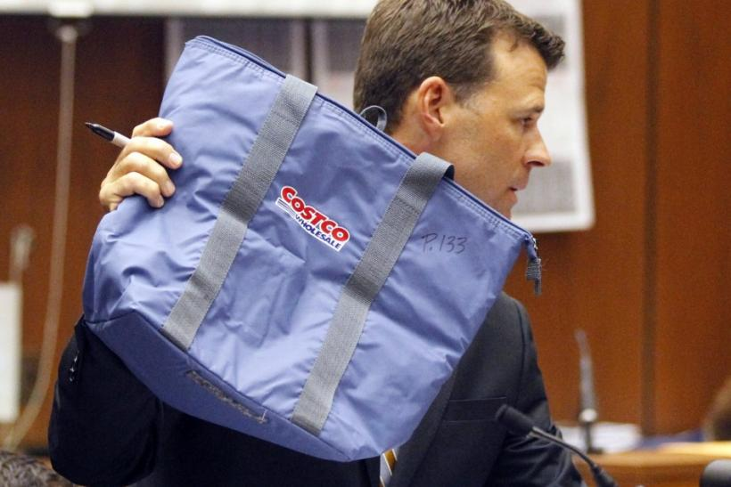 Deputy District Atorney Walgren holds a Costco bag found in the home of pop star Michael Jackson enterd as evidence during Dr. Murray's trial in Los Angeles