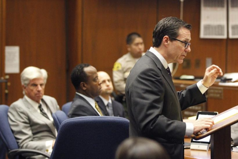Deputy district attorney David Walgren holds Dr. Conrad Murray's iPhone which was entered as evidence during Murray's trial in Los Angeles
