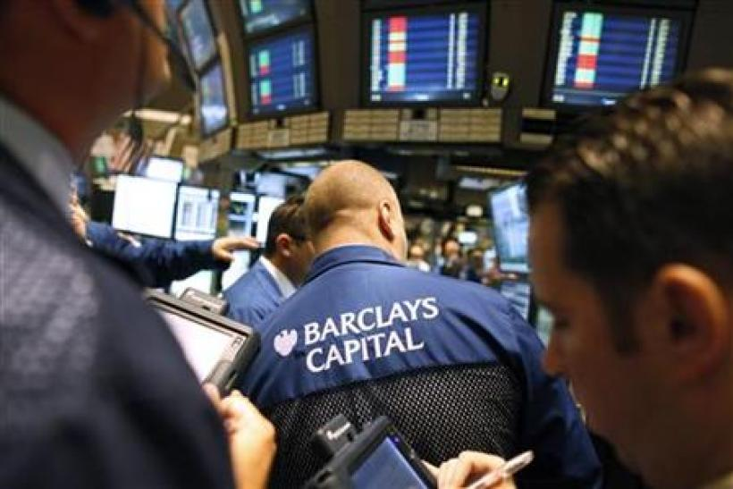 Traders gather at the Barclays Capital's kiosk on the floor of the New York Stock