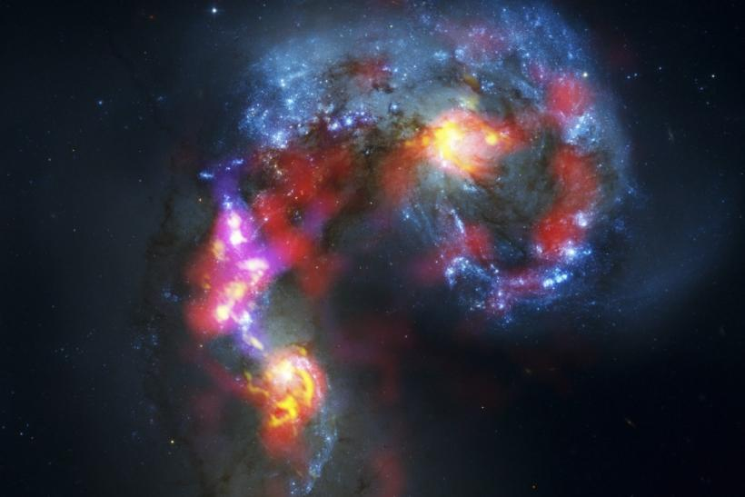 The Antennae Galaxies are seen in this image made from the parabolic antennas of the ALMA