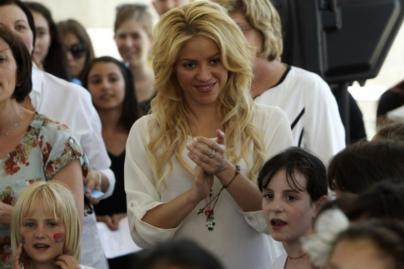 Colombian pop star and the UNICEF ambassador, Shakira, applauds as children from the Max Payne Hand in Hand School for Bilingual Education sing to her in Jerusalem