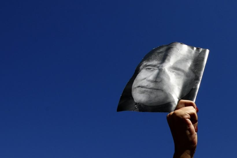 A demonstrator holds up a portrait of the late Turkish- Armenian writer Hrant Dink in Istanbul