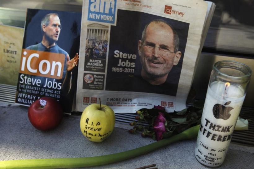 Items left at an impromptu shrine memorializing Steve Jobs are seen outside of Apple's upper west side store in New York