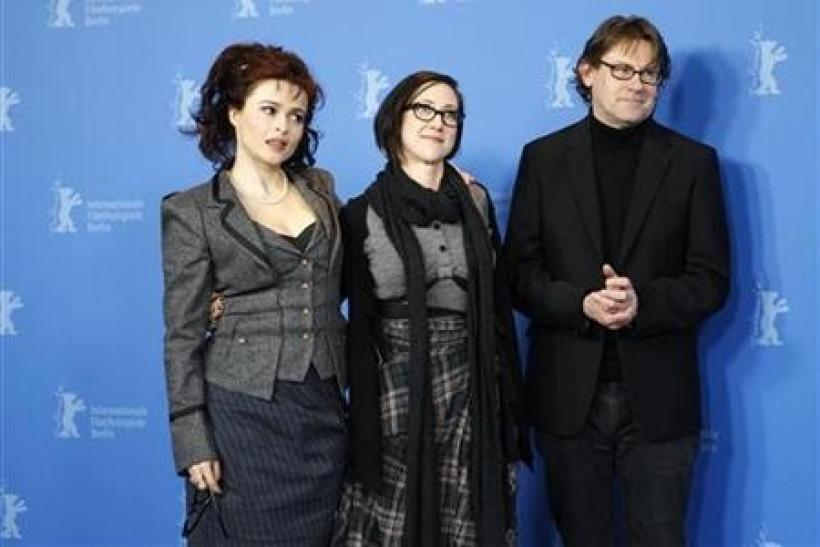 Actress Helena Bonham Carter, director SJ Clarkson and author Nigel Slater (L-R) pose during a photocall to promote the movie 'Toast' at the 61st Berlinale International Film Festival in Berlin