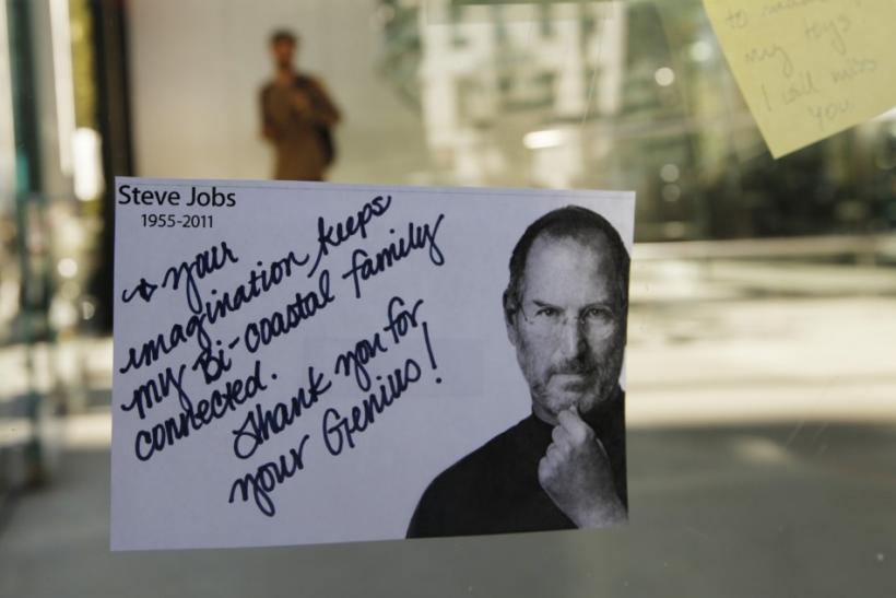 A note left to memorialize Steve Jobs is seen on the exterior of Apple's 14th St store in New York