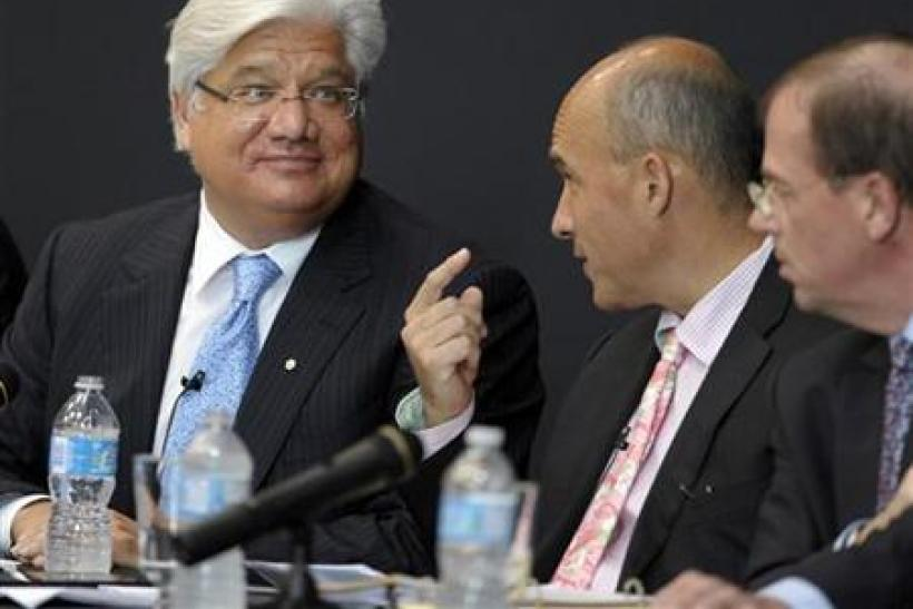 Research In Motion Co-CEOs Balsillie and Lazaridis talk during the annual general meeting of shareholders in Waterloo