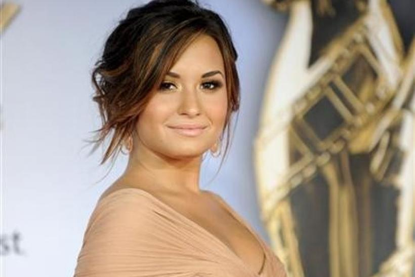 Actress and singer Demi Lovato arrives at the 2011 National Council of La Raza ALMA Awards in Santa Monica, California