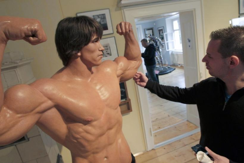 A visitor takes touches a life size figure inside the house where Austrian actor, former champion bodybuilder and former California governor Arnold Schwarzenegger was born, in the southern Austrian village of Thal