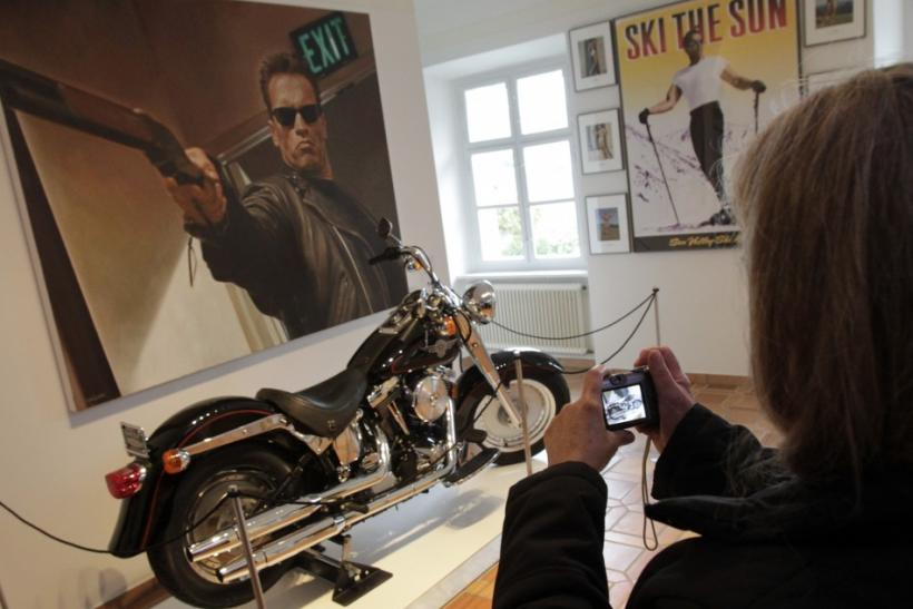 A visitor takes photographs inside the house where Austrian actor, former champion bodybuilder and former California governor Arnold Schwarzenegger was born, in the southern Austrian village of Thal