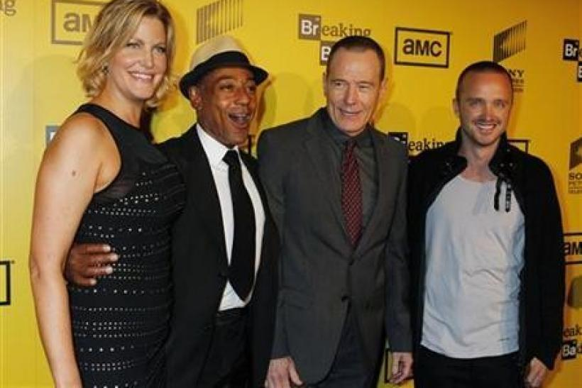 Cast members (L-R) Anna Gunn, Giancarlo Esposito, Bryan Cranston and Aaron Paul of AMC's drama television series 'Breaking Bad' pose as they arrive for the premiere screening for the show's fourth season in Hollywood, California